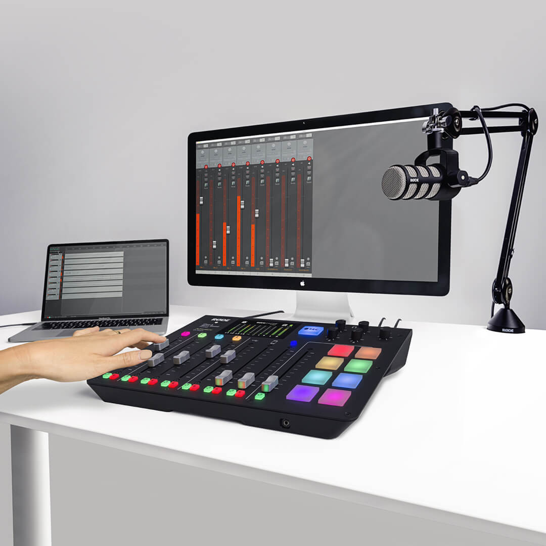 on white desk with hand on console