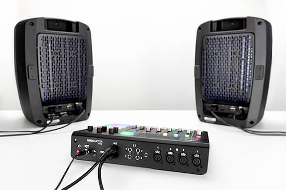 Pair of Event Opal speakers connected with TRS to XLR cables to the back of the RODECaster Pro