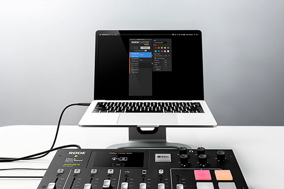RODECaster Pro in Podcast Transfer Mode connected via USB cable to an Apple Macbook pro with Companion app displayed