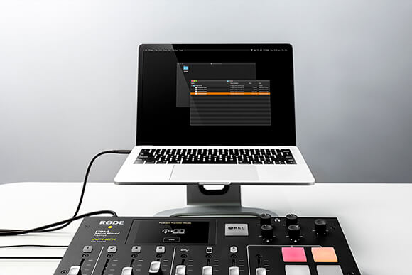 RODECaster Pro in Podcast Transfer Mode connected via USB cable to a Apple Macbook Pro with exporting option displayed