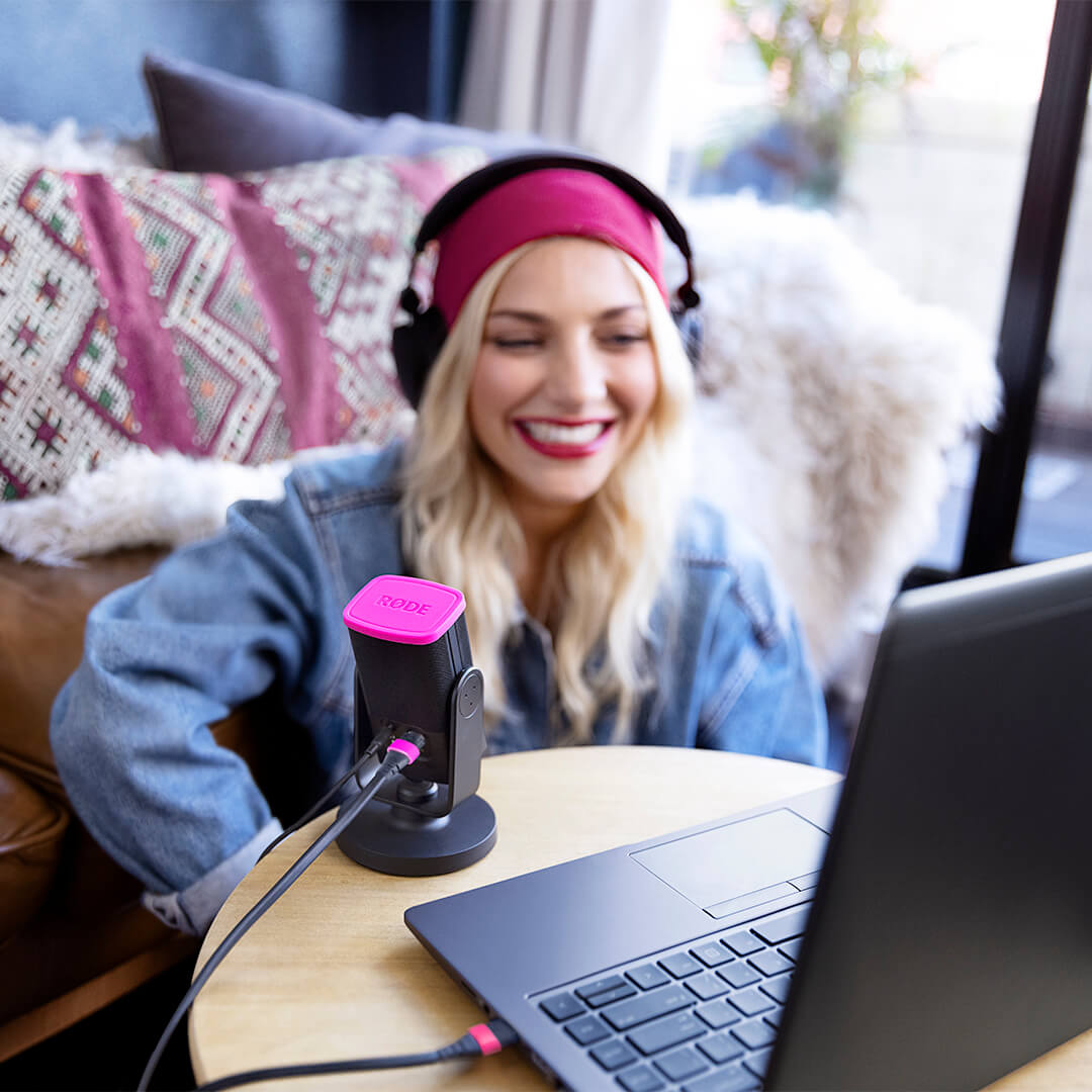 Girl with laptop and NT-USB mini microphone connected