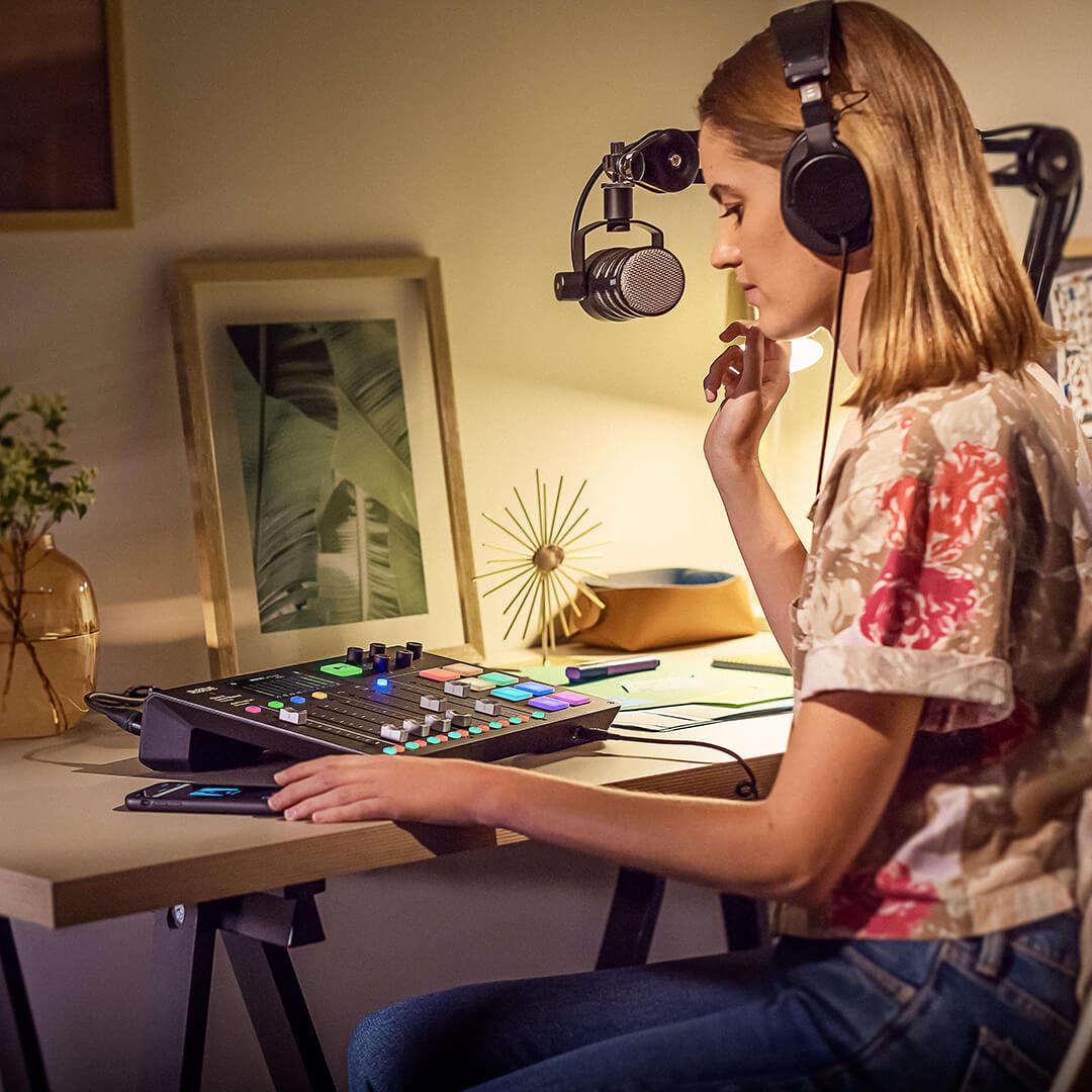 girl at home at desk with podcasting set up